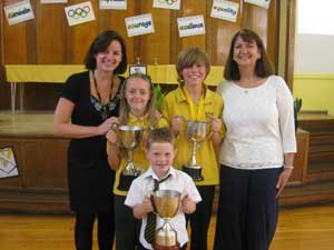 Mrs McDaid, headteacher and Yvonne Wright, present prizes