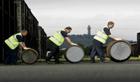 Diageo workers with barrels