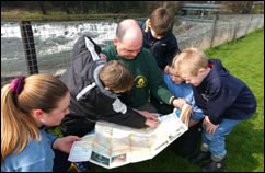Ranger and children map-reading